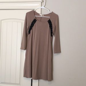 NWOT taupe dress with lace up detail at shoulders.